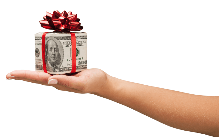 Hand holding gift wrapped in money with bow